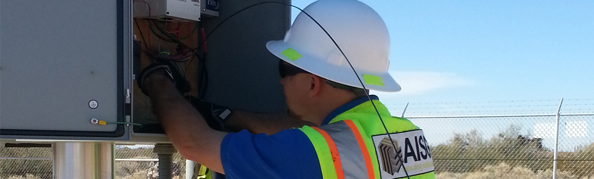 AISG technician wiring a perimeter surveillance camera