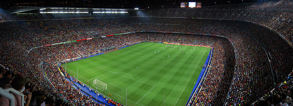 Wide angle view of packed soccer stadium