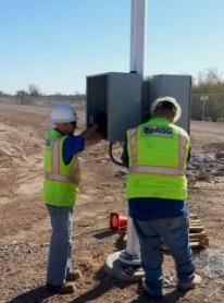 AISG technicians installing surveillance equipment