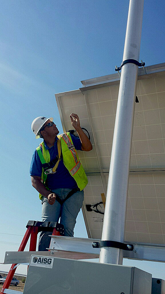 AISG tech installing security cameras at Roserock Solar Generating Facility