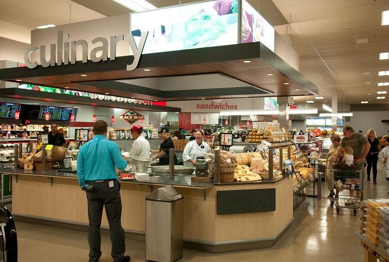 Man getting service at the culinary counter at Shop Rite Grocery Store
