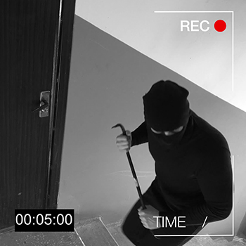 Masked burglar with crow bar caught on video surveillance