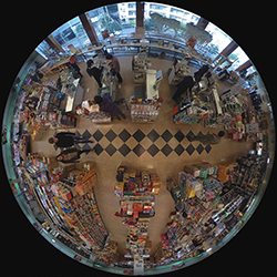 Warped 360 degree view from security camera looking down at a supermarket point of sale station